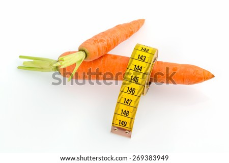 organically grown carrots with tape measure. fresh fruit and vegetables is always healthy. symbolic photo for healthy diet. - stock photo