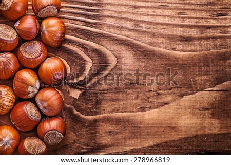 organized copyspace image hazelnuts on vintage wooden board food and drink concept  - stock photo