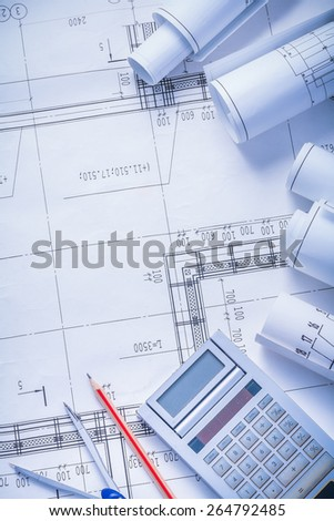 organized copyspace rolls of blueprints calculator pencil compass construction concept  - stock photo