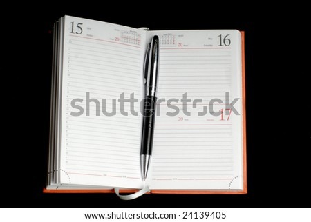 organizer and pen isolated on black background
