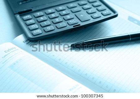 organizer and pen toned blue - stock photo