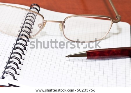 Organizer, glasses and pen. Business background