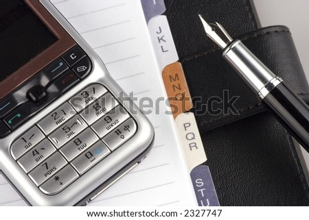 Organizer with fountain pen and mobile phone. - stock photo