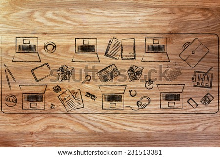 organizing and collaborating: laptops and office objects on shared desk - stock photo