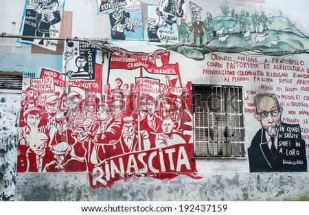 ORGOSOLO, ITALY - APRIL 02: Murals wall paintings about political and historical facts in Orgosolo, Sardinia, Italy on April 02, 2014