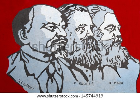 ORGOSOLO, SARDINIA, ITALY - JULY 26: Close-up about famous wall painting of Orgosolo in Sardinia, Italy on July 26, 2011. In this wall painting are represented Lenin, Engels and Marx.