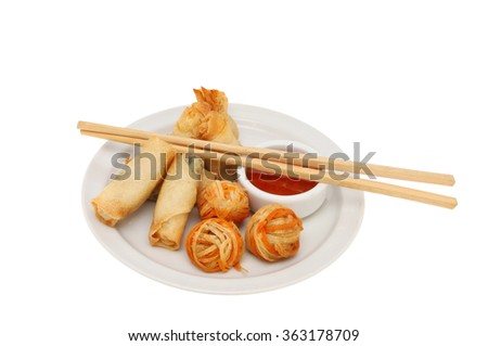 Oriental appetizers with sweet chili dipping sauce and chopsticks on a plate isolated against white - stock photo