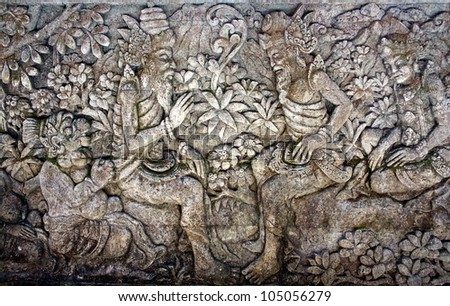 Oriental background. Two man surrounded by floral ornament. From a balinese temple - stock photo