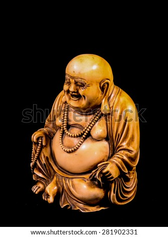 Oriental Buddist Statue Isolated on a Black Background