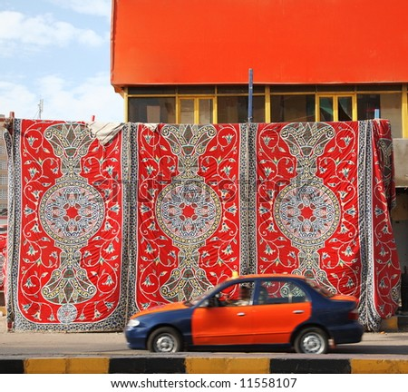 oriental carpet hangs in the streets of the Egyptian town - stock photo