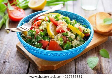 Oriental cuisine - tabouli - stock photo
