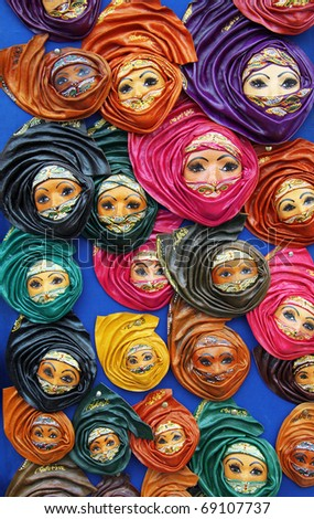 oriental decorative masks representing  Muslim woman wearing a veil - stock photo