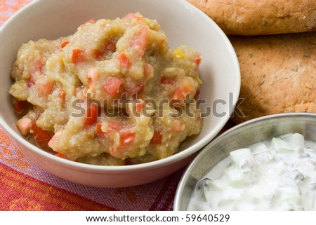 Oriental dip from aubergines and tomataoes which is a variation of babaganoush and you often find it in a traditional meze buffet.