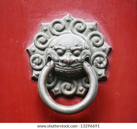 Oriental door knob, with Lion/Dragon sculpture -symbol of auspicious & guardian for Chinese belief - stock photo