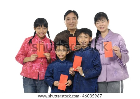 Oriental family with wearing chinese traditional dress holding a red packet wishing you Happy New Year