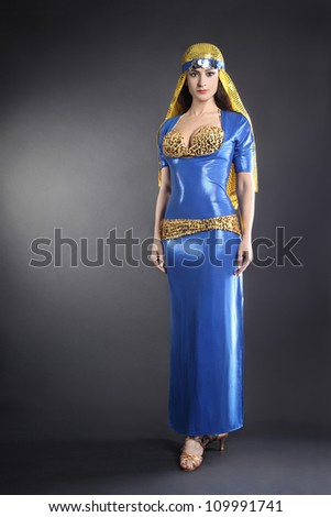 Oriental fashion woman dancer in elegant Egyptian style dress - stock photo