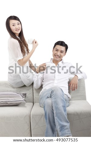 Oriental fashion young couple drinking coffee