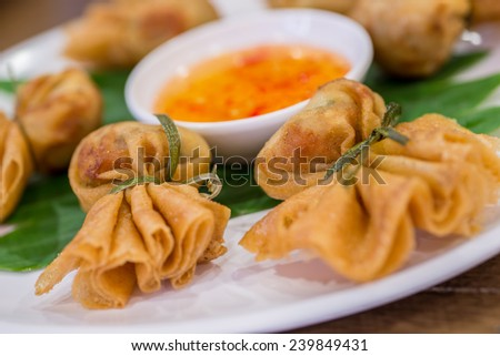 Oriental fried wonton filled with prawns and vegetables served with sweet chilli and dumpling sauce.