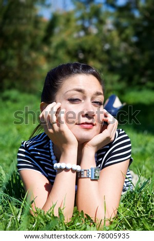 Oriental girl laying on the grass field