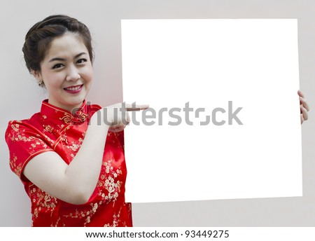 Oriental girl wishing you a happy chinese new year, with copy space.
