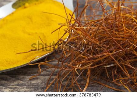 oriental indian spices curry paprika nutmeg chili cinnamon cardamom curcuma on vintage wooden table - stock photo