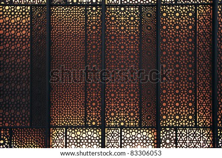 Oriental patterns Silhouette with bright red back light - stock photo