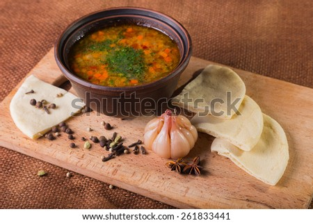 Oriental soup. Eastern food. Arab food. Soup with bread. - stock photo