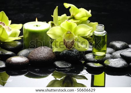 Oriental spa with orchid , candle and pebbles