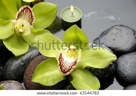 Oriental spa with orchid , candle and pebbles - stock photo