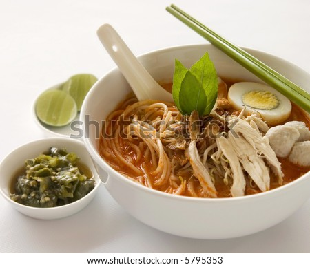 Oriental spicy curry Laksa soup with green chili - stock photo