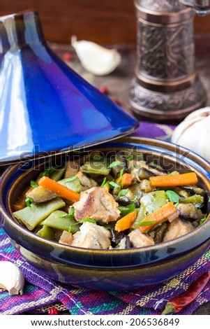 Oriental stew with meat, vegetables, green beans, carrot in tagine, tasty moroccan dish - stock photo