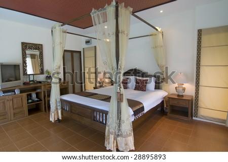 Oriental style resort bedroom - stock photo