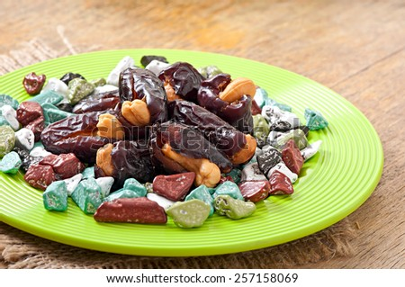 Oriental sweets - sun dried dates stuffed with cashew and chocolates - stock photo