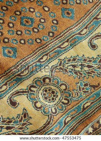 Oriental textile closeup. More of this motif & more textiles in my port. - stock photo
