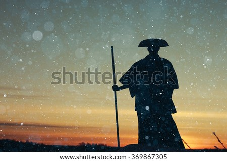 oriental warrior winter sunset - stock photo