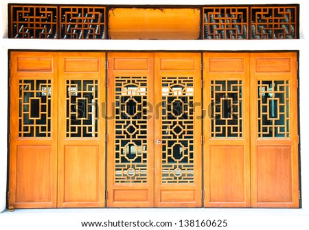 Oriental wooden door with traditional pattern - stock photo