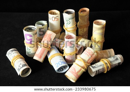Orientation in Business olled Money on a Black Background - stock photo