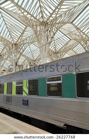 Oriente Station with train detail at Lisbon (Portugal) expo area. Gare do Oriente is one of the main transport hubs. It was designed by Santiago Calatrava and built by Necso. - stock photo