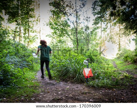 Orienteering is a family of sports requiring navigational skills using map and compass to navigate from point to point in diverse and usually unfamiliar terrain, usually as a race - stock photo