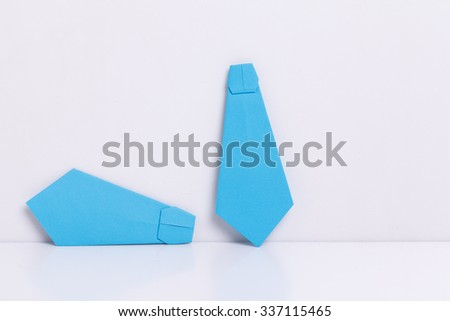 origami a man's tie shirt on a white background. - stock photo