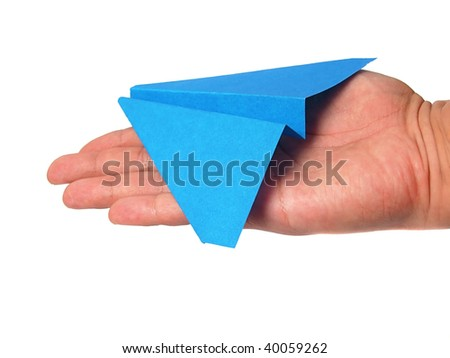 Origami airplane in hand - stock photo