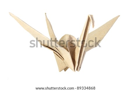 Origami bird made from brown recycle paper isolated on white background - stock photo