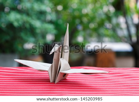 Origami Bird made of bag Paper - stock photo