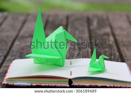 Origami Bird on Handmade notebook - stock photo