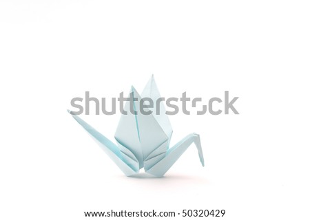 Origami bird over white. Child paper articles. - stock photo