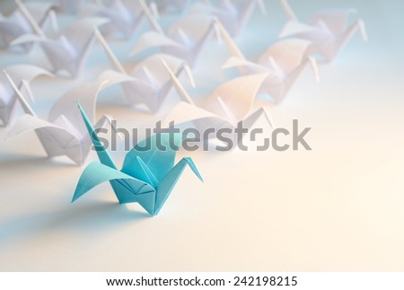 Origami birds flying to the light - stock photo