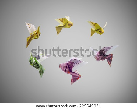 origami birds of euro money fly out - stock photo