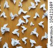 Origami birds on the wooden door. - stock photo