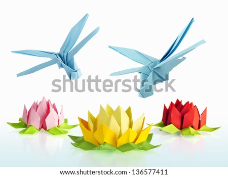 origami blue dragonfly over flowers lotus over white background - stock photo
