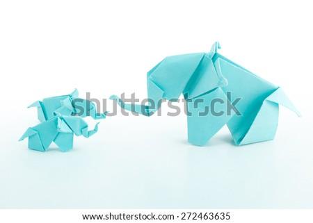 Origami blue elephant family on white background.Teaching baby elephant - stock photo